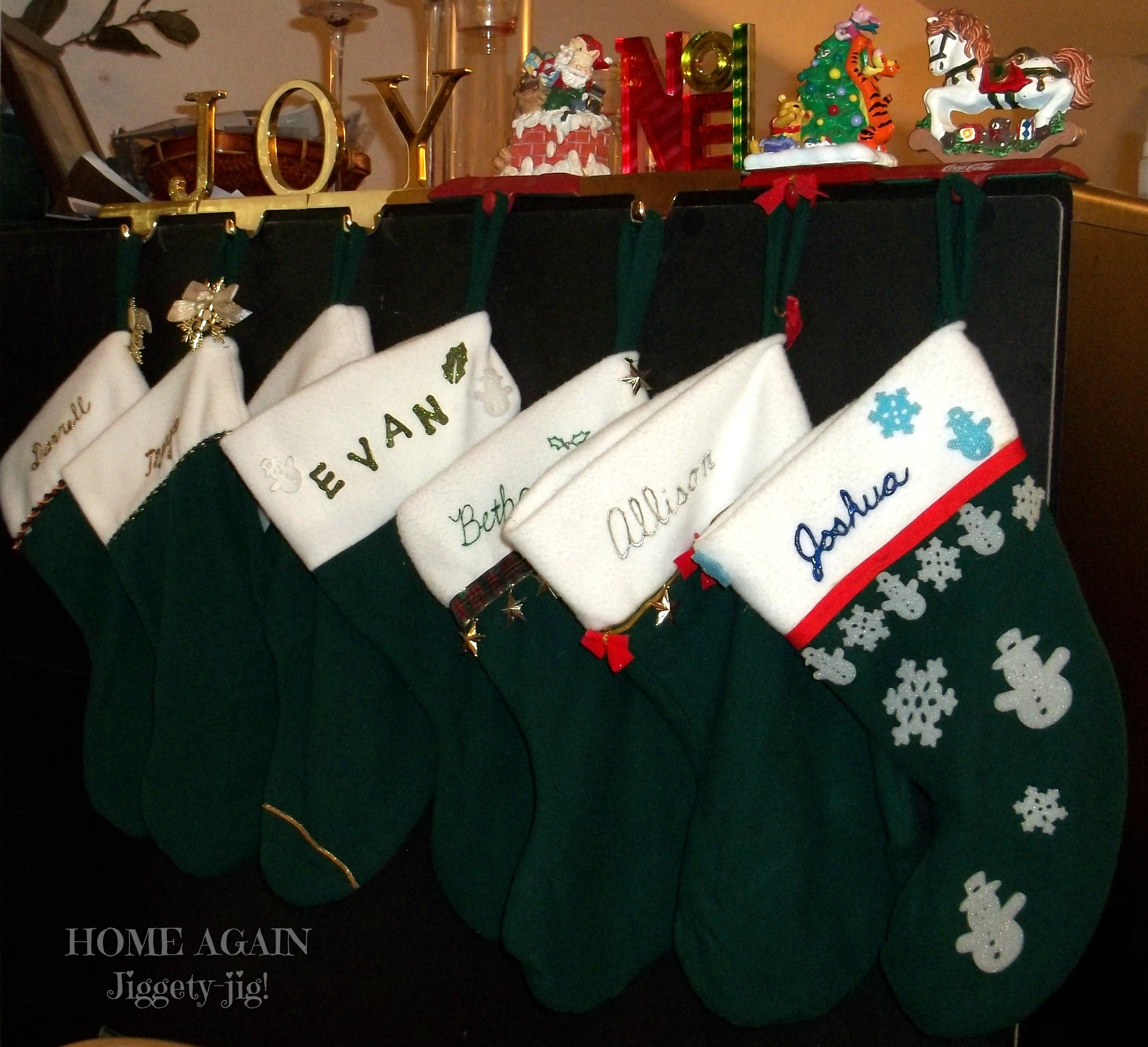 I bought material to sew new ones, using a current Christmas stocking as a pattern, and each kiddo decorated his or her own stocking.